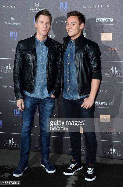 Dustin Lance Black and Tom Daley attend the inaugural Battersea Power Station annual party held at Battersea Power station on April 30 2014 in London...