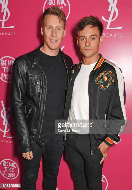 Dustin Lance Black and Tom Daley attend the #YSLBeautyClub party in collaboration with Sink The Pink at The Curtain on August 3 2017 in London England