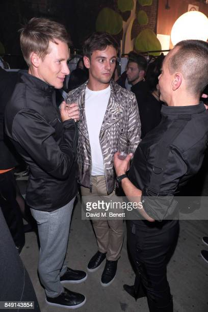 Dustin Lance Black and Tom Daly with Designer Julien Macdonald backstage at the Julien Macdonald Spring Summer 2018 Show sponsored by Ciroc at The...