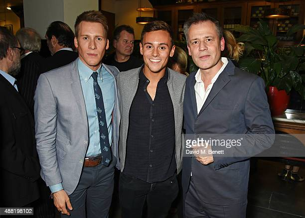 Dustin Lance Black Tom Daley and Michael Grandage attend the 'Photograph 51' press night after party at the The National Cafe on September 14 2015 in...