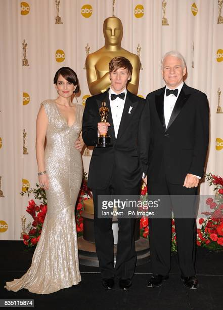 Dustin Lance Black with Tina Fey and Steve Martin and the Best Original Screenplay award for Milk at the 81st Academy Awards at the Kodak Theatre Los...