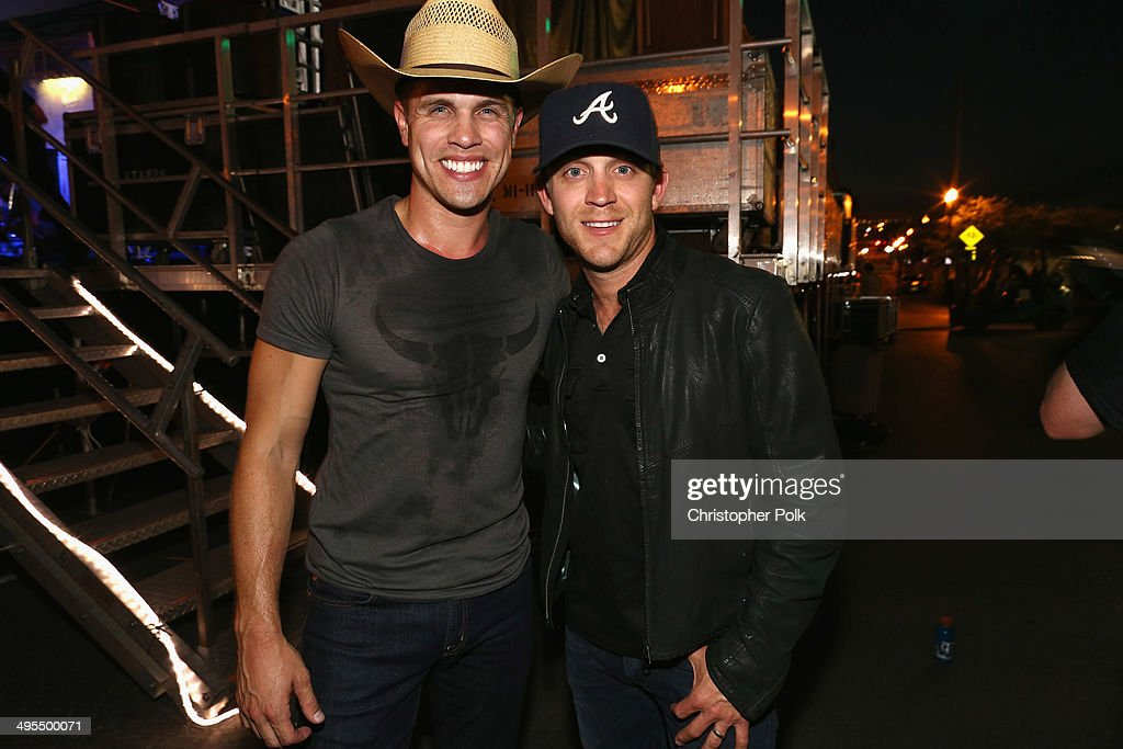 Dustin Lynch and Justin Moore pose backstage during Rodney Atkins 4th Annual Music City Gives Back on June 3, 2014 in Nashville, Tennessee.