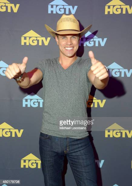 Dustin Lynch poses at HGTVs The Lodge at CMA Music Fest 2014 on June 6 2014 in Nashville Tennessee