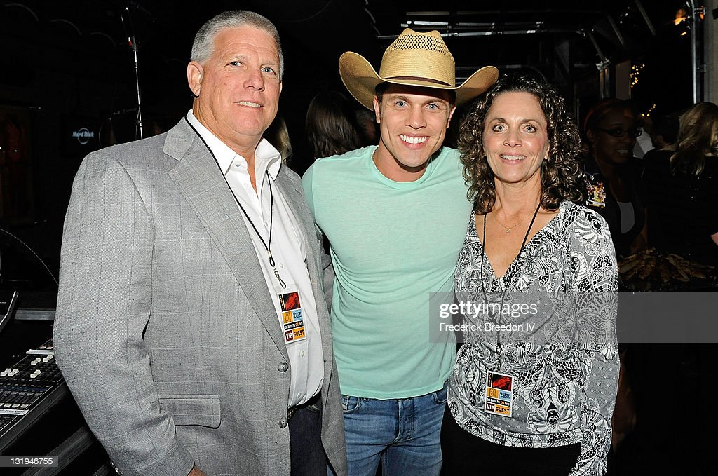 Dustin Lynch poses with his parents Chuck and Patti at the Broken Bow/Stoney Creek Records 2nd annual CMA pre-party at the Hard Rock Cafe on November 8, 2011 in Nashville, Tennessee.