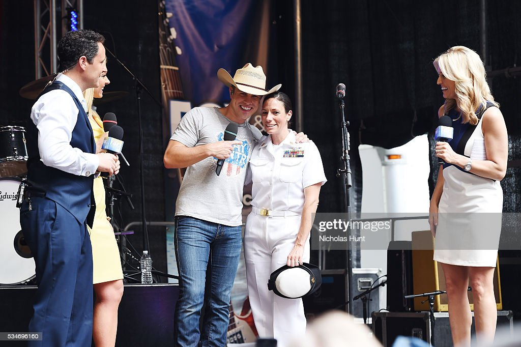 <a gi-track='captionPersonalityLinkClicked' href=/galleries/search?phrase=Dustin+Lynch&family=editorial&specificpeople=8612719 ng-click='$event.stopPropagation()'>Dustin Lynch</a> takes photo with Navy Captain during 'FOX & Friends' All American Concert Series outside of FOX Studios on May 27, 2016 in New York City.