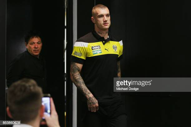 Dustin Martin a winner of the Brownlow medal last night arrives for his press conference with manager Ralph Carr behind ahead of the Richmond Tigers...