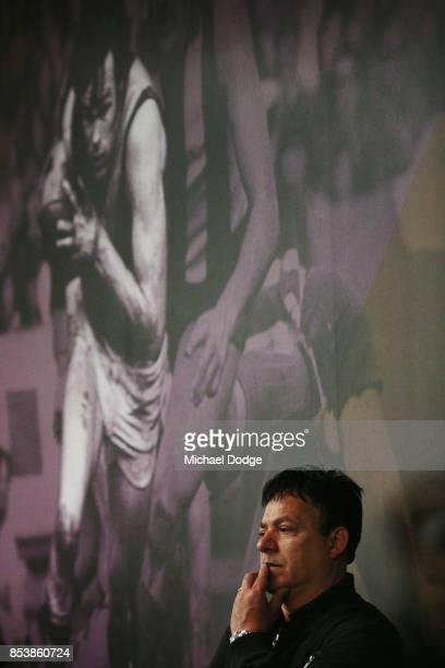 Dustin Martin a winner of the Brownlow medal last night speaks to media at his press conference as his manager Ralph Carr listens here ahead of the...