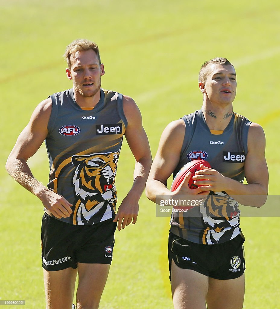 Dustin Martin and Luke McGuane of the Tigers run during a Richmond Tigers AFL training session at ME Bank Centre on April 16, 2013 in Melbourne, Australia.
