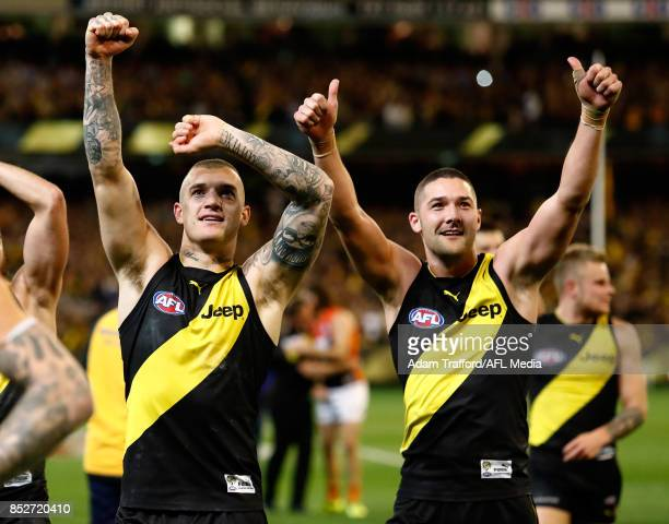 Dustin Martin and Shaun Grigg of the Tigers thank fans during the 2017 AFL Second Preliminary Final match between the Richmond Tigers and the GWS...