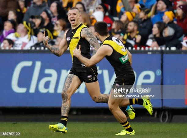 Dustin Martin and Trent Cotchin of the Tigers celebrate during the 2017 AFL round 23 match between the Richmond Tigers and the St Kilda Saints at the...