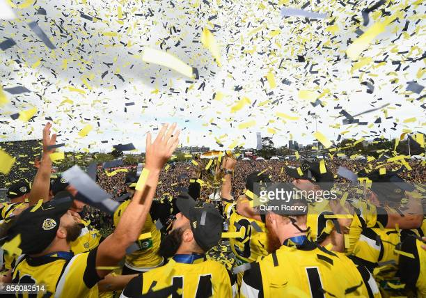 Dustin Martin and Trent Cotchin of the Tigers show the Premiership Trophy to the crowd after winning yesterday's AFL Grand Final at Punt Road Oval on...