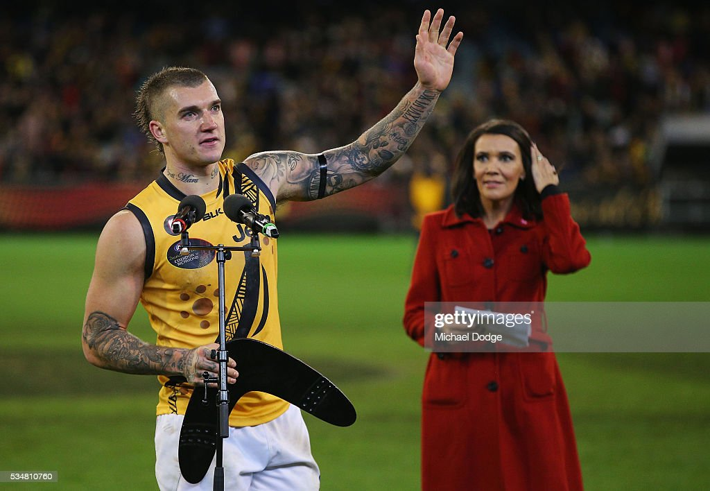 <a gi-track='captionPersonalityLinkClicked' href=/galleries/search?phrase=Dustin+Martin&family=editorial&specificpeople=5404528 ng-click='$event.stopPropagation()'>Dustin Martin</a> of the Tigers accepts his boomerang for his best afield performance during the round 10 AFL match between the Essendon Bombers and the Richmond Tigers at Melbourne Cricket Ground on May 28, 2016 in Melbourne, Australia.