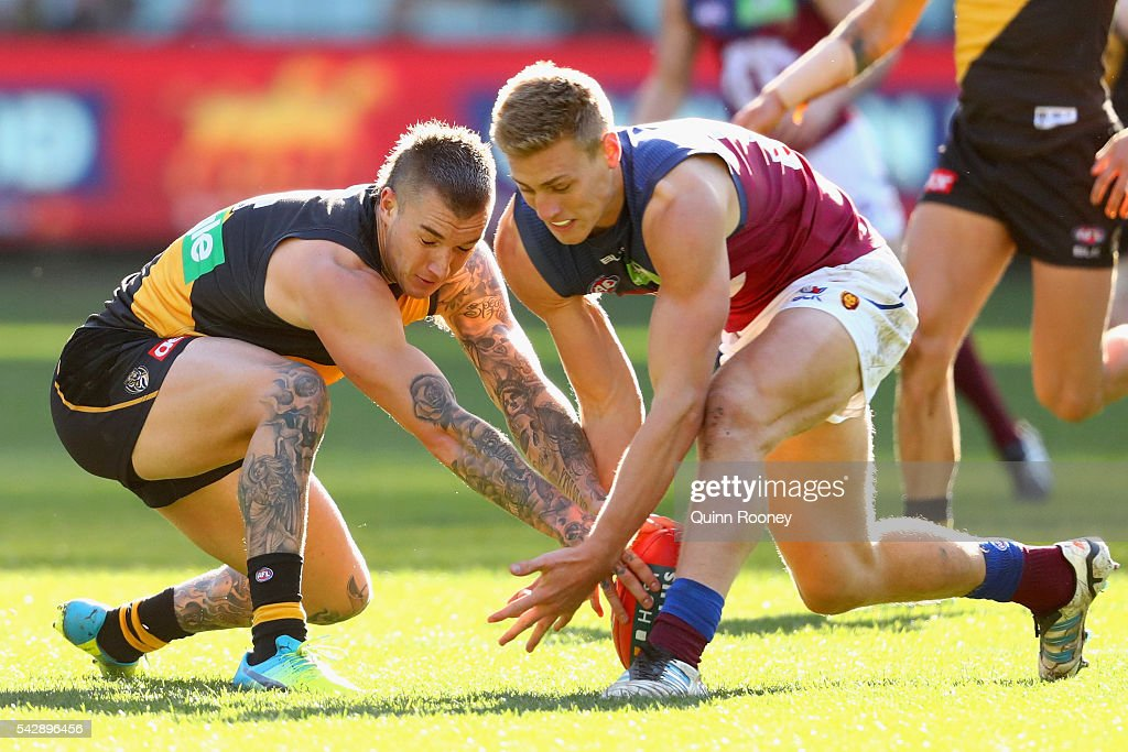 <a gi-track='captionPersonalityLinkClicked' href=/galleries/search?phrase=Dustin+Martin&family=editorial&specificpeople=5404528 ng-click='$event.stopPropagation()'>Dustin Martin</a> of the Tigers and Jarrad Jansen of the Lions compete for the ball during the round 14 AFL match between the Richmond Tigers and the Brisbane Lions at Melbourne Cricket Ground on June 25, 2016 in Melbourne, Australia.