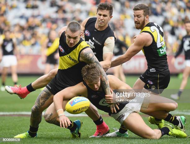 Dustin Martin of the Tigers and Patrick Cripps of the Blues compete for the ball during the round 14 AFL match between the Richmond Tigers and the...