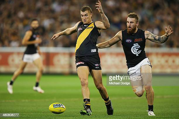 Dustin Martin of the Tigers and Zac Tuohy of the Blues contest for the ball during the round two AFL match between the Richmond Tigers and the...