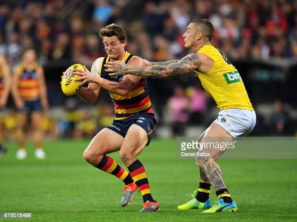 Dustin Martin of the Tigers attempts to tackle Matt Crouch of the Crows during the round six AFL match between the Adelaide Crows and the Richmond...