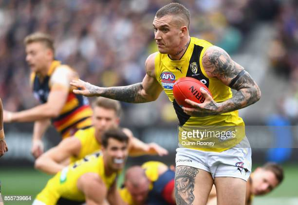 Dustin Martin of the Tigers breaks free of a pack during the 2017 AFL Grand Final match between the Adelaide Crows and the Richmond Tigers at...