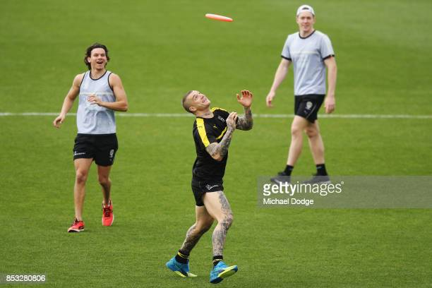 Dustin Martin of the Tigers catches a frisby during a Richmond Tigers AFL media oportunity at Punt Road Oval on September 25 2017 in Melbourne...