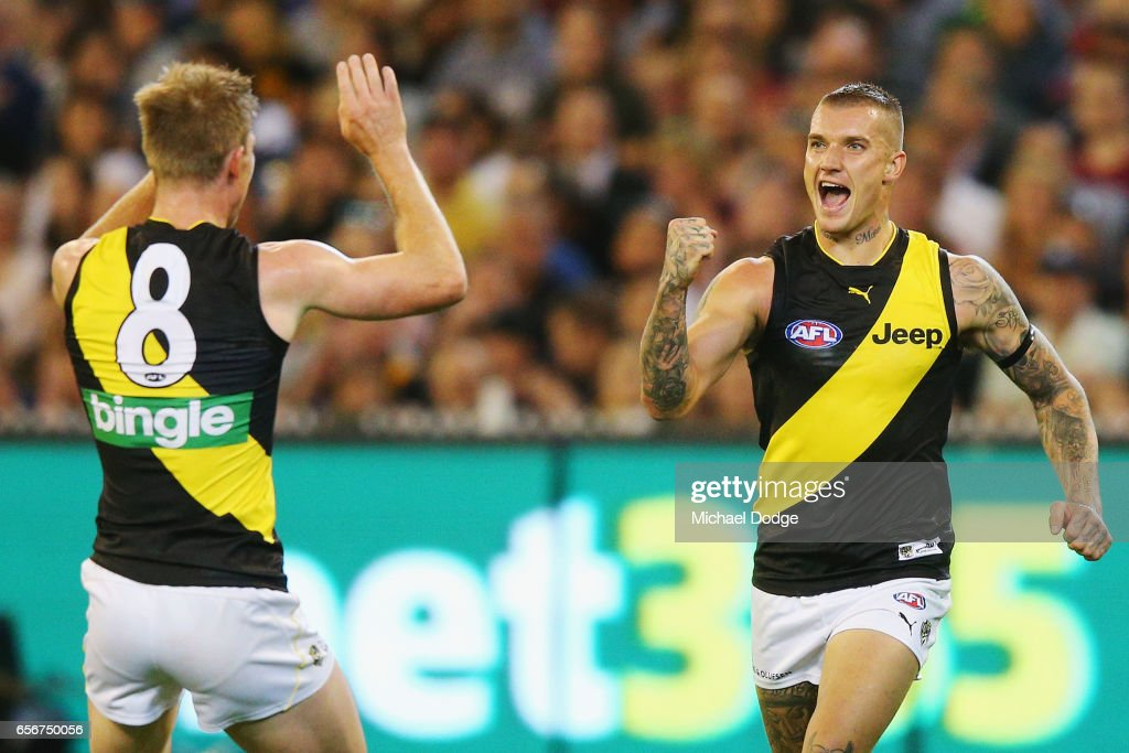 Dustin Martin of the Tigers celebrates a goal with Jack Riewoldt of the Tigers (L) during the round one AFL match between the Carlton Blues and the Richmond Tigers at Melbourne Cricket Ground on March 23, 2017 in Melbourne, Australia.