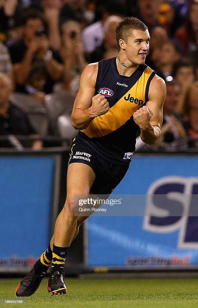 Dustin Martin of the Tigers celebrates kicking a goal during the round three AFL match between the Richmond Tigers and the Western Bulldogs at Etihad Stadium on April 14, 2013 in Melbourne, Australia.