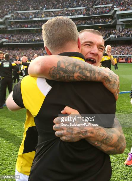 Dustin Martin of the Tigers celebrates with Damien Hardwick coach of the Tigers after winning the 2017 AFL Grand Final match between the Adelaide...