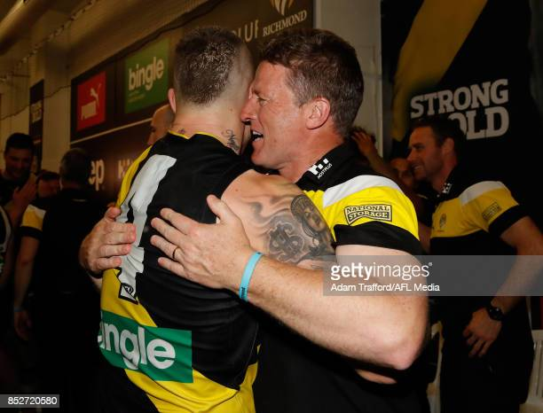 Dustin Martin of the Tigers celebrates with Damien Hardwick Senior Coach of the Tigers during the 2017 AFL Second Preliminary Final match between the...