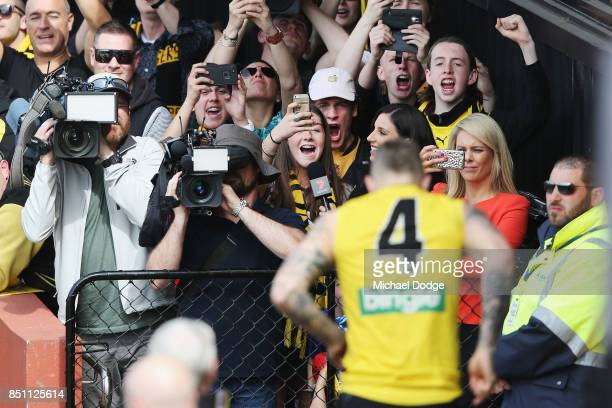 Dustin Martin of the Tigers enters the field during a Richmond Tigers AFL training session at Punt Road Oval on September 22 2017 in Melbourne...