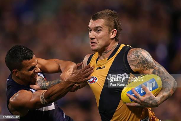 Dustin Martin of the Tigers fends off Danyle Pearce of the Dockers during the round 10 AFL match between the Fremantle Dockers and the Richmond...