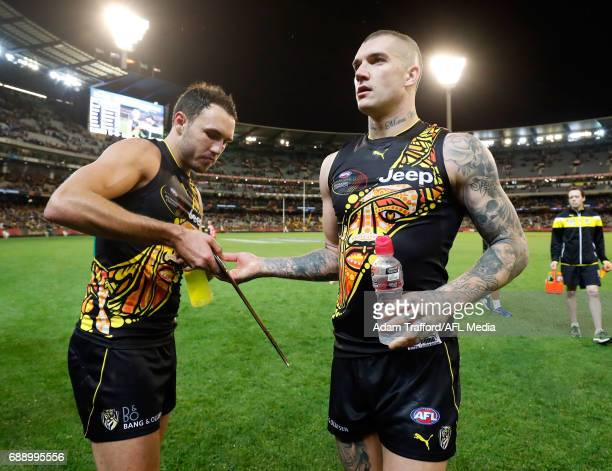 Dustin Martin of the Tigers hands his best on ground award to Shane Edwards of the Tigers during the 2017 AFL round 10 Dreamtime at the G match...