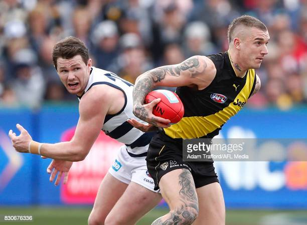Dustin Martin of the Tigers in action ahead of Patrick Dangerfield of the Cats during the 2017 AFL round 21 match between the Geelong Cats and the...