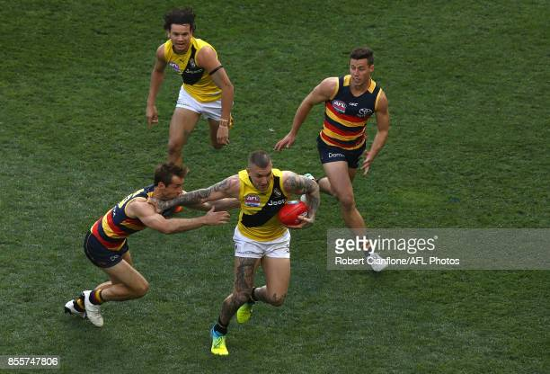 Dustin Martin of the Tigers is challenged by Richard Douglas of the Crows during the 2017 AFL Grand Final match between the Adelaide Crows and the...