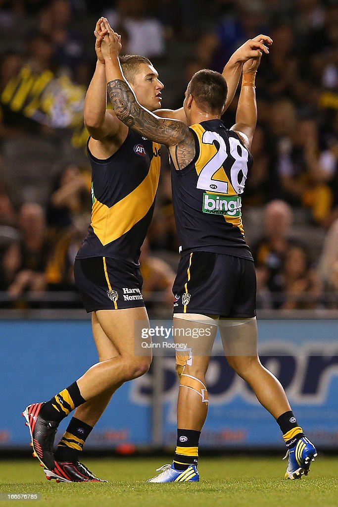 Dustin Martin of the Tigers is congratulated by Jake King after kicking a goal during the round three AFL match between the Richmond Tigers and the Western Bulldogs at Etihad Stadium on April 14, 2013 in Melbourne, Australia.