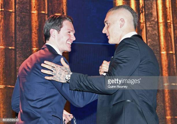 Dustin Martin of the Tigers is congratulated by Patrick Dangerfield after being awarded the 2017 Brownlow Medallist at the 2017 Brownlow Medal at...