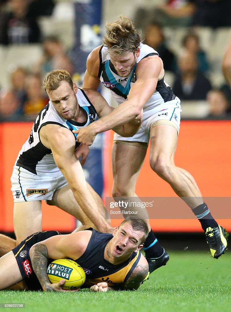 Dustin Martin of the Tigers is tackled by Brad Ebert of the Power during the round six AFL match between the Richmond Tigers and the Port Adelaide Power at Melbourne Cricket Ground on April 30, 2016 in Melbourne, Australia.