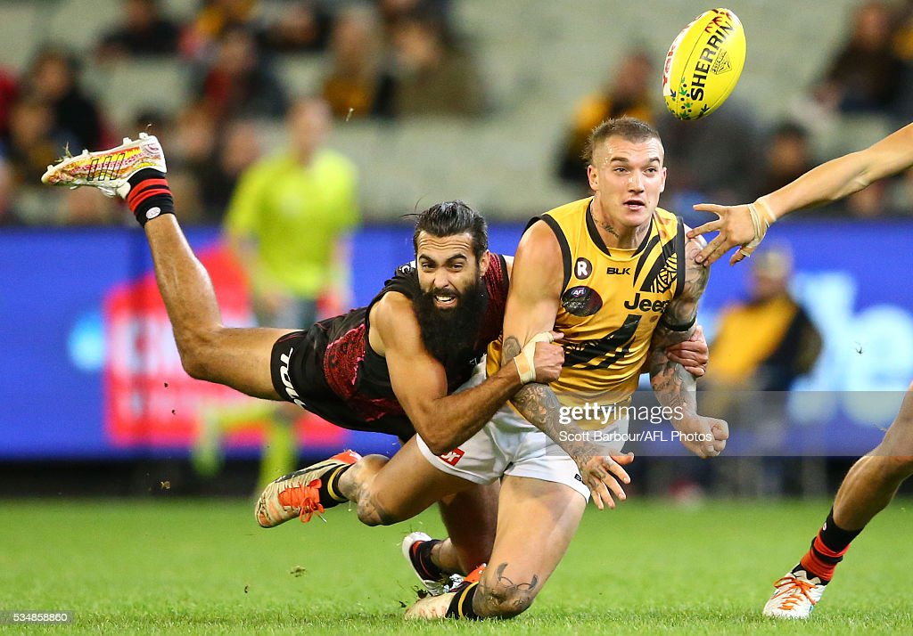 <a gi-track='captionPersonalityLinkClicked' href=/galleries/search?phrase=Dustin+Martin&family=editorial&specificpeople=5404528 ng-click='$event.stopPropagation()'>Dustin Martin</a> of the Tigers is tackled by Courtenay Dempsey of the Bombers during the 2016 AFL Round 10 Dreamtime at the G match between the Essendon Bombers and the Richmond Tigers at the Melbourne Cricket Ground on May 28, 2016 in Melbourne, Australia.