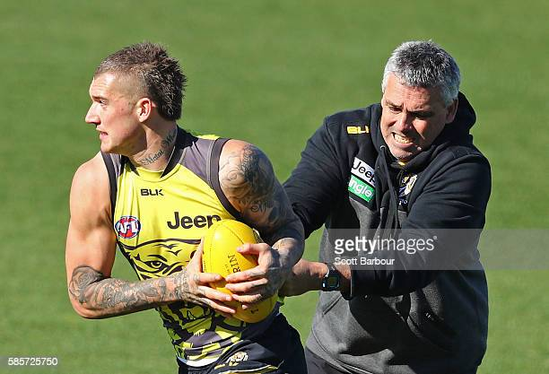 Dustin Martin of the Tigers is tackled by Mark Williams Tigers Senior Development Coach during a Richmond Tigers AFL training session at Punt Road...