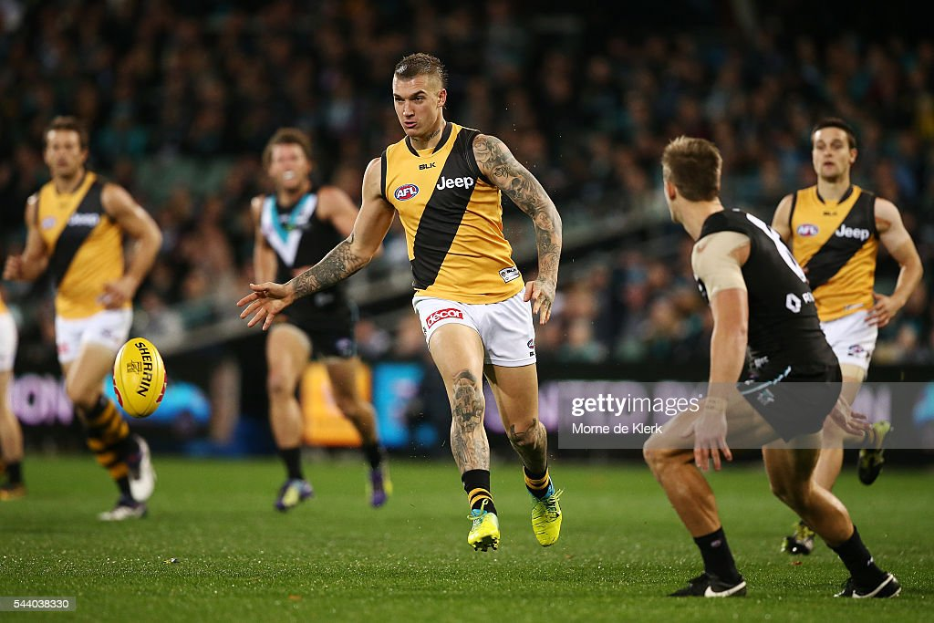 <a gi-track='captionPersonalityLinkClicked' href=/galleries/search?phrase=Dustin+Martin&family=editorial&specificpeople=5404528 ng-click='$event.stopPropagation()'>Dustin Martin</a> of the Tigers kicks the ball during the round 15 AFL match between the Port Adelaide Power and the Richmond Tigers at Adelaide Oval on July 1, 2016 in Adelaide, Australia.
