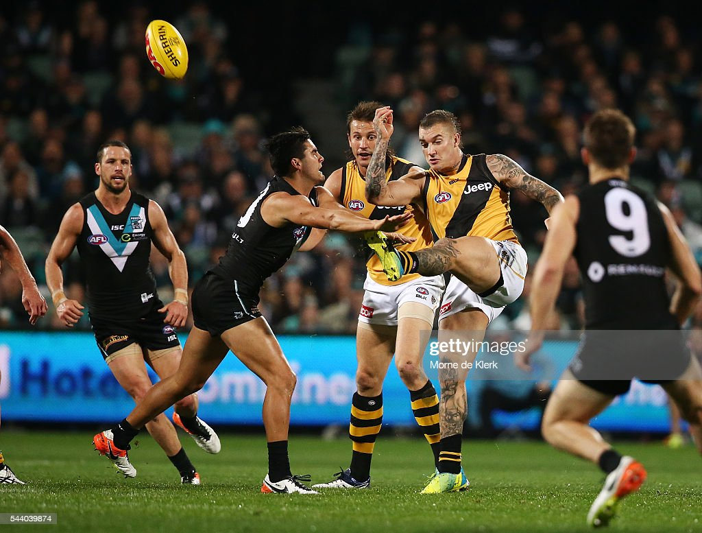 <a gi-track='captionPersonalityLinkClicked' href=/galleries/search?phrase=Dustin+Martin&family=editorial&specificpeople=5404528 ng-click='$event.stopPropagation()'>Dustin Martin</a> of the Tigers licks the ball during the round 15 AFL match between the Port Adelaide Power and the Richmond Tigers at Adelaide Oval on July 1, 2016 in Adelaide, Australia.