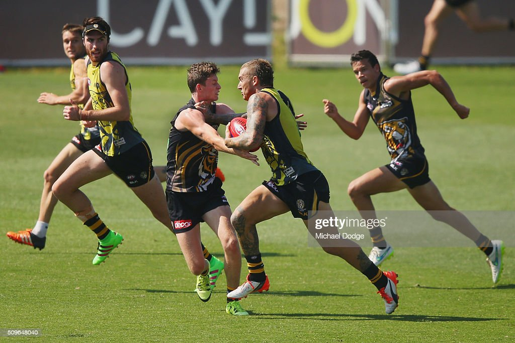 <a gi-track='captionPersonalityLinkClicked' href=/galleries/search?phrase=Dustin+Martin&family=editorial&specificpeople=5404528 ng-click='$event.stopPropagation()'>Dustin Martin</a> of the Tigers pushes away Connor Menadue of the Tigers during the Richmond Tigers AFL intra-club match at Punt Road Oval on February 12, 2016 in Melbourne, Australia.