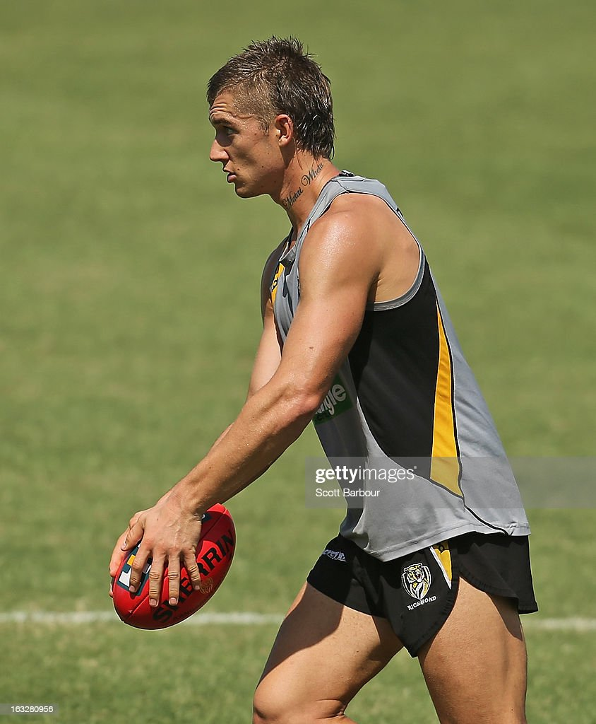 Dustin Martin of the Tigers runs with the ball during a Richmond Tigers AFL training session at ME Bank Centre on March 7, 2013 in Melbourne, Australia.
