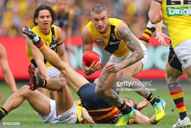 Dustin Martin of the Tigers runs with the ball during the 2017 AFL Grand Final match between the Adelaide Crows and the Richmond Tigers at Melbourne...