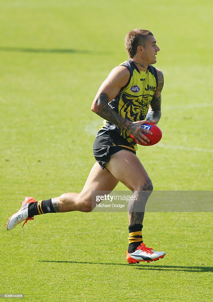 <a gi-track='captionPersonalityLinkClicked' href=/galleries/search?phrase=Dustin+Martin&family=editorial&specificpeople=5404528 ng-click='$event.stopPropagation()'>Dustin Martin</a> of the Tigers runs with the ball during the Richmond Tigers AFL intra-club match at Punt Road Oval on February 12, 2016 in Melbourne, Australia.