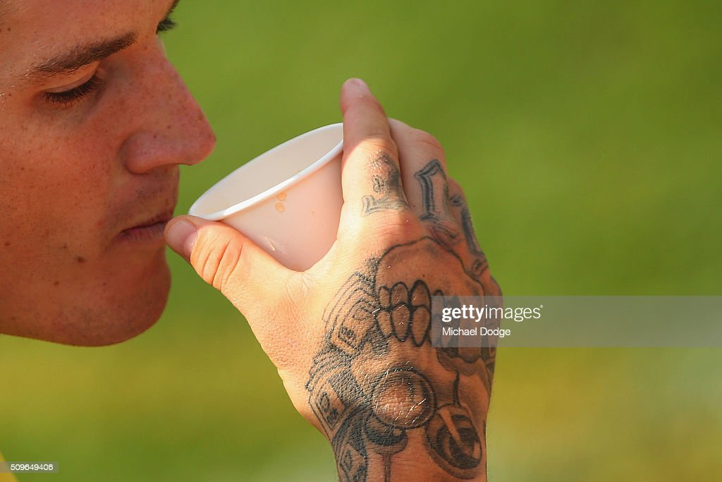 <a gi-track='captionPersonalityLinkClicked' href=/galleries/search?phrase=Dustin+Martin&family=editorial&specificpeople=5404528 ng-click='$event.stopPropagation()'>Dustin Martin</a> of the Tigers takes i a drink with his tattooed hand during the Richmond Tigers AFL intra-club match at Punt Road Oval on February 12, 2016 in Melbourne, Australia.