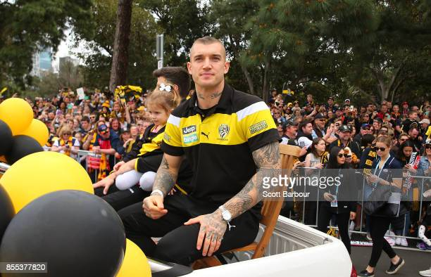 Dustin Martin of the Tigers waves to the crowd during the 2017 AFL Grand Final Parade on September 29 2017 in Melbourne Australia