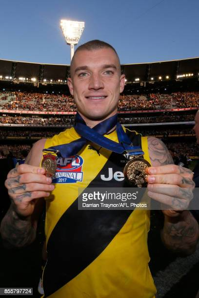 Dustin Martin of the Tigers wins the Norm Smith Medal for best on ground during the 2017 AFL Grand Final match between the Adelaide Crows and the...