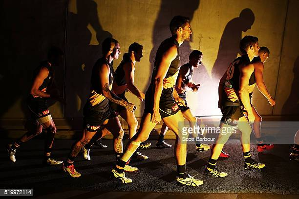 Dustin Martin Shaun Hampson and the Richmond Tigers walk onto the field during the round three AFL match between the Richmond Tigers and the Adelaide...