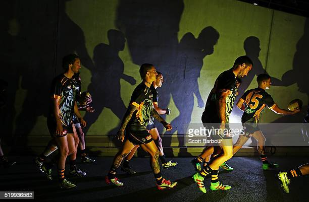 Dustin Martin Tyrone Vickery and the Richmond Tigers walk out onto the field during the round three AFL match between the Richmond Tigers and the...