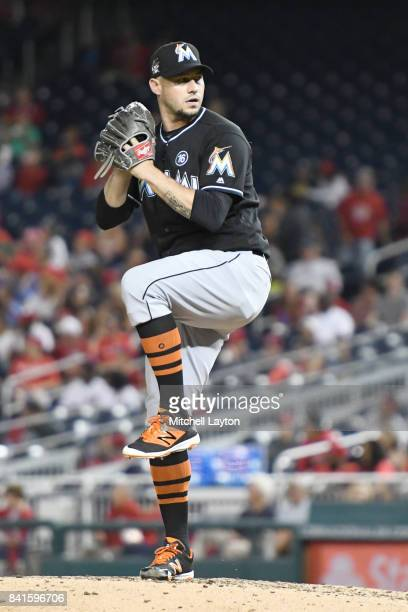 Dustin McGowan of the Miami Marlins pitches during a baseball game against the Washington Nationals at Nationals Park on August 28 2017 in Washington...