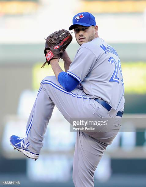 Dustin McGowan of the Toronto Blue Jays delivers a pitch against the Minnesota Twins during the first inning in game two of a doubleheader on April...