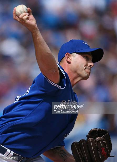 Dustin McGowan of the Toronto Blue Jays delivers a pitch during MLB game action against the Texas Rangers on June 8 2013 at Rogers Centre in Toronto...